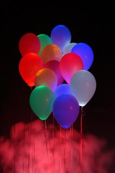 Put colored glowsticks in balloons (any color balloon) and put it in,beside, or above the pool