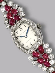 RUBY AND DIAMOND WRISTWATCH, CIRCA 1930 Old European-cut and single-cut diamonds weighing approximately 4.90 carats, mounted in platinum, manual movement, dial signed Tiffany & Co., Switzerland, length 7 5/8  inches.
