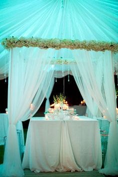similar structure for the sweets table with hanging blooms