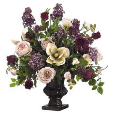 Faux lilac and rose arrangement with magnolia and hydrangea accents. Includes carved pedestal urn.  Product: Faux floral arrange...