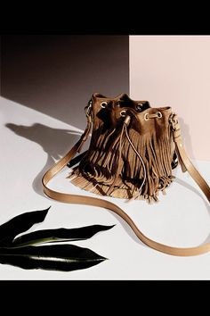 <strong>2. THE BAG</strong> A suede bucket style only benefits from the addition of fringe. Saint Laurent by Hedi Slimane bag, <em>$1,990, 212-980-2970</em>