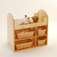 """Doll Changing Table - Lay baby on the soft mat nestled inside the changing table with wicker storage baskets underneath for all baby's needs. Birch changing table includes beige mat and 4 wicker baskets. Measures 24"""" L. x 15"""" W. x 24"""" H.  - $209.99"""