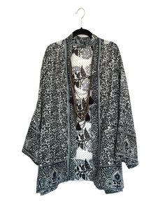 A personal favourite from my Etsy shop https://www.etsy.com/listing/229472675/silk-kimono-jacket-black-and-white