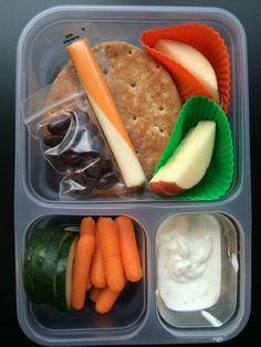Copycat Starbucks PB&J bistro box - almond butter and jelly sandwich, carrots, cucumbers, apple slices, cheese stick, Greek ranch dip and dark chocolate covered raisins.