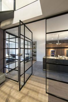 Apartments, Cool Kitchen Design Of Amsterdam Apartment With Glass Railings In Dark Steel Frame Door Kitchen Cabinet Wooden Ceramic Floor Staircase Ceiling Lamp Pendant Spot Light Storage: Fascinating Interior Design of Family Apartment with Visual Connection in Amsterdam
