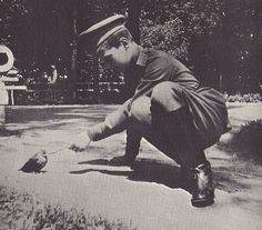 Alexei and bird photo Alexeiandbird-1917.png