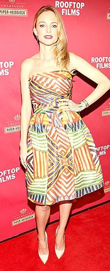 Heather Graham colorful on the carpet in a strapless dress with a tea-length hemline.