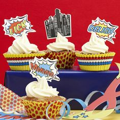 A Pop Art themed Cupcake Decorating Set containing brightly coloured cupcake cases and an assortment of toppers to stick in the top of the cupcakes to dress up them up. 25 red spotty cupcake cases, 25 colourful stripey cupcake cases and 20 toppers