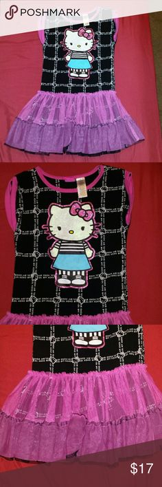 """OFFERS! Girls Sz 6/6X Hello Kitty Dress Please feel free to make a ???REASONABlE??? offer on this top.  LIKE NEW - WORN MAYBE SIX TIMES & WASHED.  Hello Kitty Dress With Pink/Black TuTu Attached At Bottom. Super Adorable! Girls Size 6/6X.  Black Dress With White Hello Kitty Images & The Words """"XOXO"""", """"LOL"""", & """"BFF"""" In White Making The Squares.  Includes Picture Of HK In Black & Ehite Striped Top & Blue Skirt, Outlined With Pink Glitter.  SMOKE & PET FREE HOME Hello Kitty Dresses Casual"""