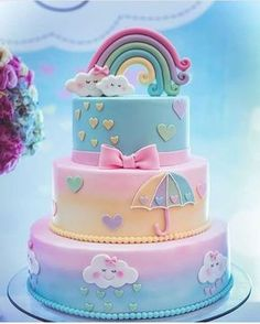 A rainbow cake is fun to look at and eat and a lot easier to make than you might think. Here's a step-by-step guide for how to make a rainbow birthday cake. Baby Cakes, Girl Cakes, Baby Shower Cakes, Cupcake Cakes, Cakes For Baby Showers, Macaron Cake, Cake Fondant, Fondant Toppers, Cloud Cake