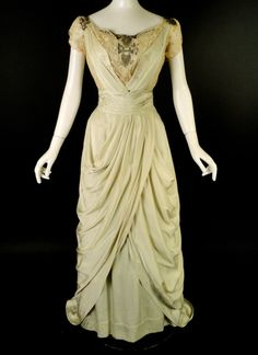 Stunning evening gown from c.1910. The gown is made in a very pale celery green silk with ivory lace and silver beading. Boned lining in ivory silk hook closures down the back.  http://vintage-martini.myshopify.com/collections/womens-clothing-edwardian/products/c-1910-green-silk-lace-evening-gown-new-item