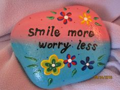 Painted rock Smile more, worry less. Size of the rock is approx. 5 x 4 x 1. Acrylic paints, sealed with clear gloss coating for color protection. Use as paperweight or decoration. Thank you for visiting my PlaceForYou shop! Please came back soon to see new items...