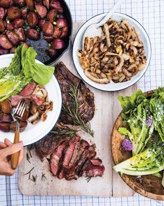 Rosemary Grilled Steak with Sweet Onions | Martha Stewart - What could be simpler or more delicious than bone-in rib-eye steaks marinated with fresh rosemary then grilled?  #grillrecipes #summerrecipes