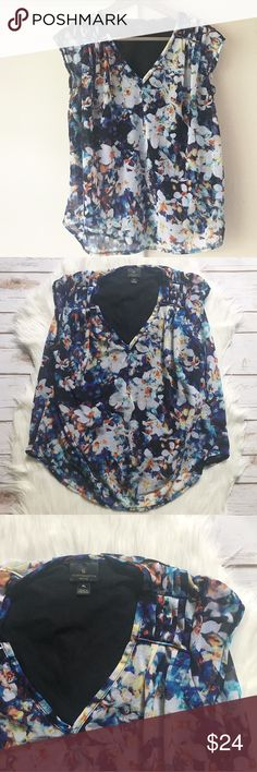 """Floral V-neck Top Floral, v-neck top. Top layer a bit sheer. Lined. Cap sleeves. Pleat detail on top of shoulders. Shell and lining 100% Polyester. Measurements on one side when laid flat: Length about 23"""" from top of shoulders to hem. Underarm to underarm about 19"""". Lining hem about 20"""". Petite Large. In excellent condition. Worthington Tops Blouses"""
