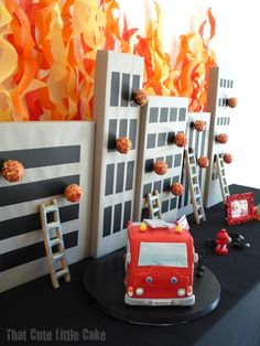 {HEART} the fabulous decorations & fire truck cake! The fires on the buildings are cake pops! Clever!
