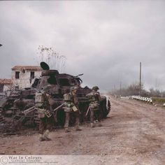 nfantry attached to the British 8th Army, pass a knocked-out German Panzer IV tank on 'Route 9' to Faenza, Italy 24 November 1944.