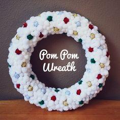 I love pom pom wreaths. White pom poms with sparkly ones throughout. Got glue?