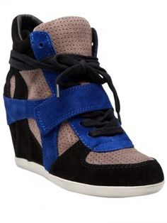 """$180.00 Bowie wedge sneaker in black from ASH. This suede wedge high-top sneaker features a round toe, calf suede upper with tri-color detail, one velcro strap, and a lace up front. Sits on 3""""wedge heel."""