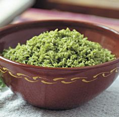 Arroz Verde (green rice) ... green from cilantro AND spinach. Great way to sneak some veggie to the kids.