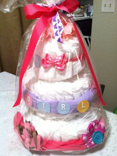 For my dear friend T.  This diaper cake is decorated with onesies, headband and hairpins.  Loved making a diaper cake for a baby girl.  I hope my friend likes it.