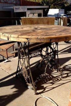 Do you recognize the base on this wooden spool table top? It is sewing machine legs from an antique Singer!