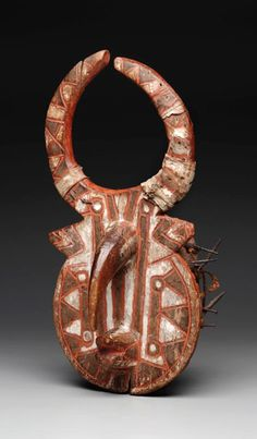 Africa | Buffalo mask ~ sigma ~ from the Vagala people (Nyamase group) of the Bole area of Ghana | Wood, camwood, paint, nails, wrought iron, animal hide, sheet metal, fiber, and paste-like substance | Early to mid 20th century