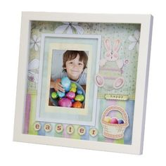 Easter Shadow Box Picture Frame by Neil Enterprises. $14.00. Design features Easter bunny, eggs in a basket, and flowers. Includes mattes that will hold a 5x7, 4x6, or 3.5x5 photo. The perfect gift for Easter!. Back of frame has an easel for placing on a table top or a hook for hanging on the wall. Inspired by the embellishments of scrapbooking and blended with modern day decor, the shadow box personifies crafty, whimsical, and festive design elements. A versati...