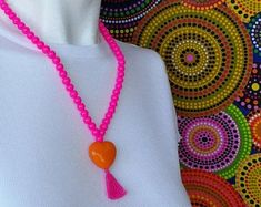 Trendy pink necklace in the street style of the Ndlovu Youth Choir currently wowing audiences on America's Got Talent. #pink #africanstreetvibe #necklace #South_Africa #African_woman #African_fashion #beads #heart #charm_necklace www.etsy.com/africanstreetvibe