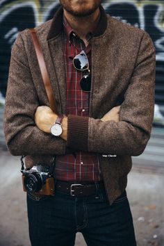 Nice jacket. I like the specs and check shirt.