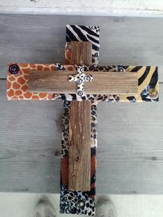 This was made with a piece of paneling, I used modge podge to glue and seal the materials over the paneling..I used old fencing on top, glued a few buttons here and there..I had a cross I picked up at a flea market, it was a necklace for a buck.  I fastened it to the center...either glue or nail...