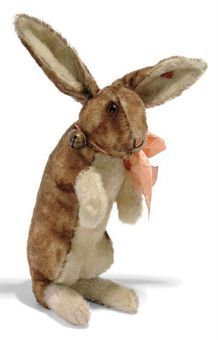 A STEIFF LARGE BEGGING RABBIT, (4344,2), brown-tipped and white mohair, brown and black glass eyes, pink and black stitching, swivel head, inoperative squeaker and FF button with red cloth tag, circa 1930 --14¾in. (38cm.) high (slight wear)