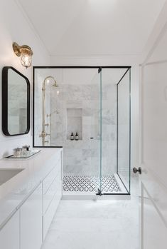 Modern bathroom features a black framed shower enclosure filled with marble tiles fitted with a tiled shower niche as well as a polished nickel vintage gooseneck shower head over a black and white geometric tiled floor. Shower Tile Designs, Best Bathroom Designs, Bathroom Trends, Modern Bathroom Design, Bathroom Interior Design, Contemporary Bathrooms, Bath Design, Bathroom Goals, Design Design