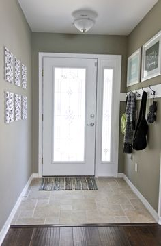 entry way - gives me an idea to extend door with a mirror (in leau of side window) to reflect more light in that corner