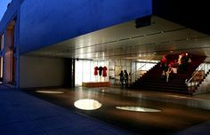 """Prada on Rodeo Drive has, a """"signature wide staircase that doubles as a museum-like stage for the clothes and shoes."""""""