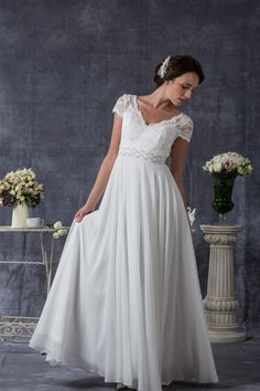 An adorable neckline and lace sleeves. Absolutely love this demure gown!