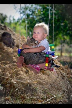 Baby and cat on a swing :)