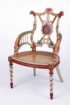 An English carved and painted armchair, dated about 1785, in the new Ornament Gallery in the V chair is one of a set from the Music Room at Woodhall Park, Herefordshire, and has been tentatively attributed to George Brookshaw.