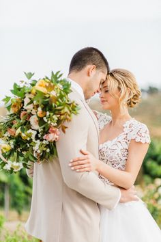 Have you seen a more stunning bouquet (and wedding dress!) for a vineyard wedding? Also loving the groom's light colored suit. | Michelle Garibay Events