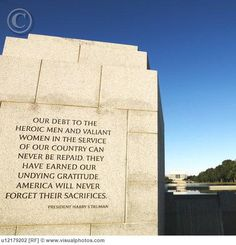World War II Memorial inscription and a view of the Lincoln Memorial