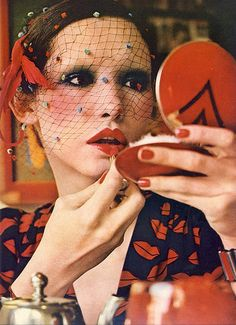 Cathee Dahmen wearing lip-print blouse by YSL | Photo by Peter Knapp for Vogue UK, June 1971