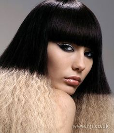Hair was coloured black through the mid lengths and ends with a crimped texture and smooth through the top     Hairstyle by: Trevor Sorbie artistic team  Hairstyle picture by: Stephan Ziehan