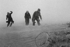 """Men Caught in Dust Bowl Storm: The dense clouds of a Dust Bowl storm were known as """"Black Blizzards."""""""