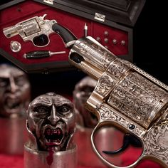 The Vampire Hunter's Colt. This Colt .38 Special Detective revolver is fitted within a coffin-shaped ebony case that holds holy water, a mirror, a wooden stake, and essential silver bullets cast in the shape of miniature vampire heads. This silver plated revolver includes an elaborate Gothic engraving by Francolini, featuring bats on the cylinder, a cross at the muzzle, and a rampant colt on a coffin. NRA Museum.
