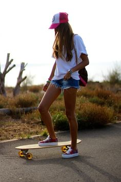 I would love to penny board ( although she's riding a different board ) where she is. It looks so cool and relaxing. I also love her cute but casual outfit!