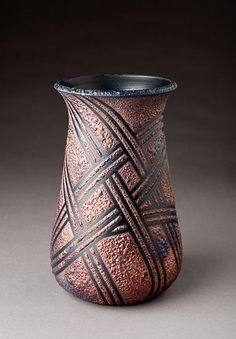 https://flic.kr/p/71r4m3 | Raku Vase | Raku pottery has its roots in the production of bowls for 16th century Japanese tea ceremonies. Hand-molded clay was fired quickly to low temperatures, removed from the kiln while hot and cooled quickly in open air or water.  The modern variations of Raku technique dispense with the lead glazes and have been extended in many ways.  While preserving the low-temperature firing (approximately 1700 degrees Fahrenheit (925 degrees Celsius), and the quick…