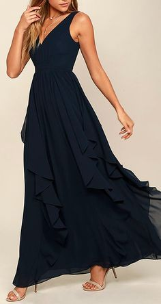 The Simply Sweet Navy Blue Maxi Dress is the dress you've been dreaming of! Lovely chiffon shapes a gathered, princess seamed bodice with a V-neck and back. A banded waist tops a flowy maxi skirt with flaring, ruffled godets. #lovelulus