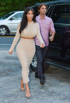 Pin for Later: Whoa, Kim Kardashian Went Nude! Kim Kardashian's Nude Dress The two-piece combo is right on par with Kim's usually sexy styles, only made more scandalous by its nude hue.
