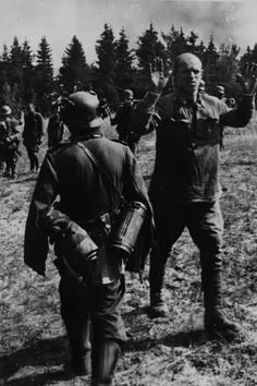 Prisoners. ... WW2.A Russian soldier surrenders to a German army unit in August 1941.