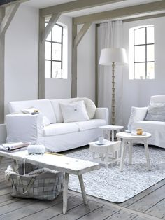 white living room with pale grey painted beams