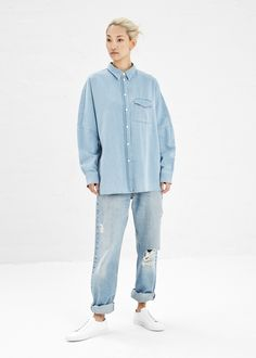 Long-sleeved, oversized button-up with dropped shoulders in light blue  cotton. 6c9fc838e9c